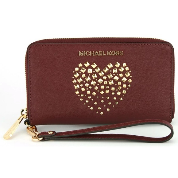 6cae8dca85af Michael kors studded heart wallet ph case merlot. NWT